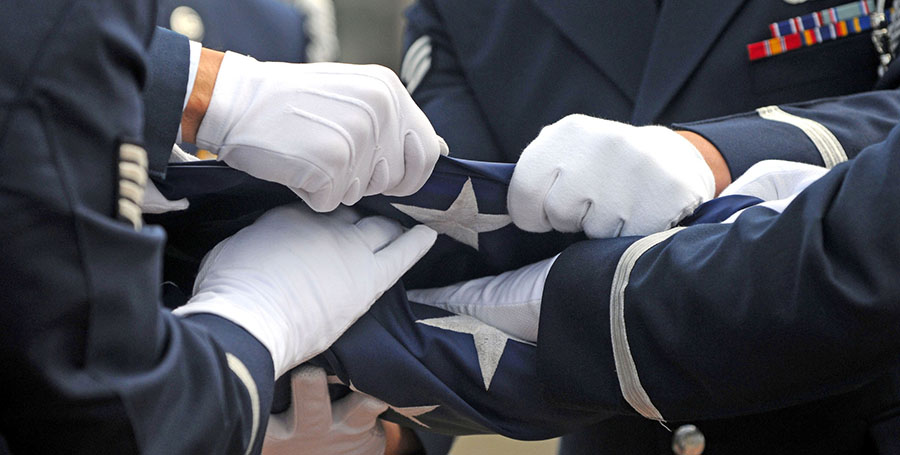 Members of the 86th Airlift Wing base honor guard conduct a flag-folding ceremony during the Ramstein Honor Guard Appreciation Day, Sept. 11, 2009, at Ramstein Air Base, Germany. (U.S. Air Force photo/Staff Sgt. Charity Barrett)